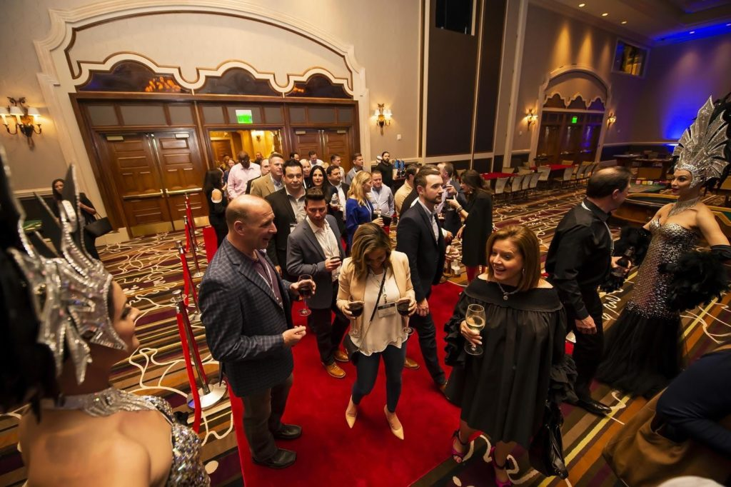 People entering an event on the red carpet